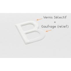 Pelliculée mat + vernis sélectif + gaufrage